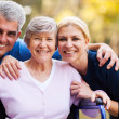 Stock Photo: Mid age couple and senior mother