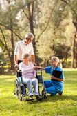 Female doctor greeting recovering senior patient in wheelchair — Stock Photo