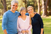 Mid age couple and senior mother outdoors — Stock Photo