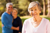 Senior woman in front of middle aged son and daughter-in-law — Foto Stock