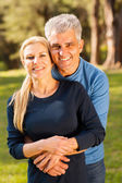 Middle aged couple hugging — Stock Photo