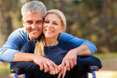 Mid age man and disabled wife — Stock Photo