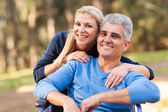 Loving wife and disabled husband outdoors — Stock Photo