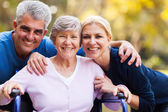 Mid age couple and senior mother — Stock Photo