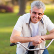 Stock Photo: Middle aged mon bike