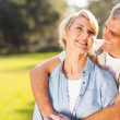 Middle aged couple embracing outdoors — Stock Photo #29903391