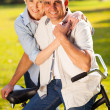 Mature couple with a bicycle — Stock Photo