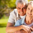 Senior man hugging wife — Stock Photo