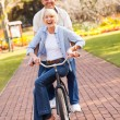 Senior couple cycling in a park — Stock Photo