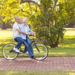 Mature couple enjoying bicycle ride — Stock Photo