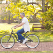 Stock Photo: Mid age mriding bicycle