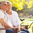 Foto Stock: Elegant mid age couple daydreaming retirement outdoors