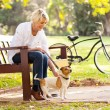 Mature woman with pet dog outdoors — Stock Photo