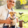 Mature man pet dog — Stok fotoğraf