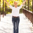 Mid age woman with arms outstretched — Foto Stock