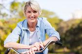 Senior woman on a bicycle — Stock Photo