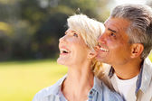 Middle aged couple bird watching — Stock Photo