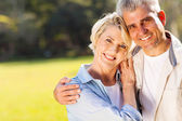 Loving middle aged couple outdoors — Stock Photo