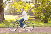 Mid age man riding bicycle — Stock Photo
