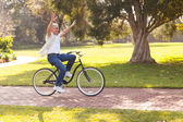 Playful middle aged man riding a bike outdoors — Stock Photo