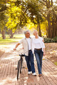 Mid age couple walking outdoors — Stock Photo