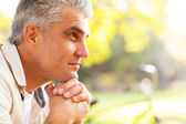 Thoughtful middle aged man — Stock Photo