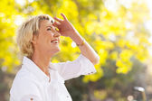 Mature woman looking up — Stock Photo