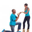 African man putting engagement ring on his girlfriend after she — Stock Photo