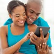 图库照片: Africamericmarried couple using tablet computer
