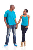Young african couple standing on white background — Stock Photo