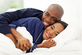 Lovely african american couple in bed — Stock Photo