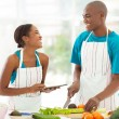 Young african couple in home kitchen  — Stock Photo