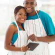 African american couple in home kitchen — Stock Photo #29968413