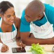 Young african american couple searching for a recipe — Stock Photo