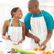 Afro american couple preparing green salad — Stock Photo #29968569