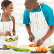 African husband and wife cooking dinner together — Stock Photo