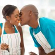 Young african couple eating a slice of tomato — Stock Photo