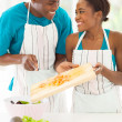 African couple preparing a salad — Stock Photo