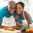 African couple in kitchen — Stock Photo