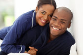 Happy african couple in nightwear — Stock Photo