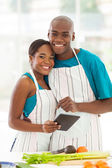 African american couple in home kitchen — Stock Photo