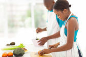 Young african woman chopping tomato — Stock Photo