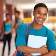Young college boy holding books — Stock Photo