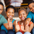 Group of students with thumbs up — Stock Photo