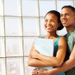 Stock Photo: Young african college couple embracing