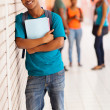 African college boy standing with books — Stock Photo
