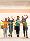 Group of college students waving — Stock Photo