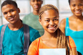 African american college girl with group of friends — Stock Photo