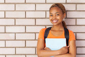 Young african university girl standing against the wall — Stock Photo