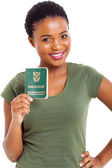 Young woman holding south african ID book — 图库照片